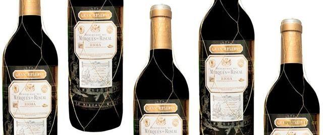 葡萄酒上本没有金丝网,造假的人多了,就有了金丝网